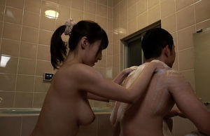 Huge-titted Asian Chick Takes a Bathroom