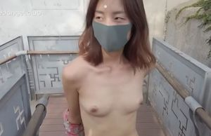 Asian lady walk bare senior monument..